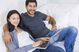 Asian Chinese Couple Using Laptop at Home