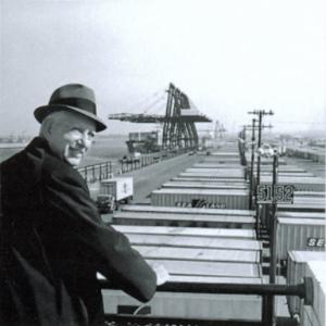 Malcolm_McLean_at_railing,_Port_Newark,_1957_(7312751706)