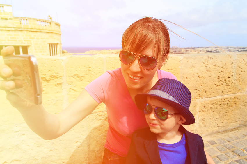 mother and little son making selfie while travel in Europe, Malta