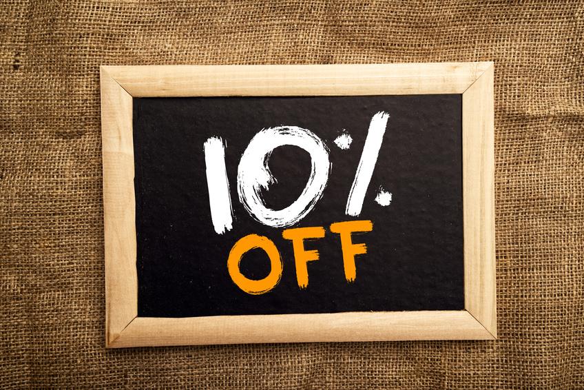 Ten percent off, discount tag on blackboard.