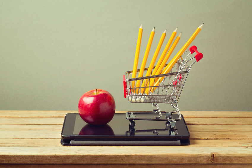 Back to school concept. Apple and pencils with tablet device on wooden table